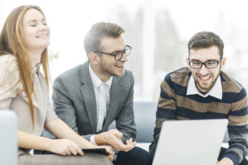 successful business team with laptop at workplace discuss working questions.