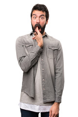 Handsome man with beard making suicide gesture on white background