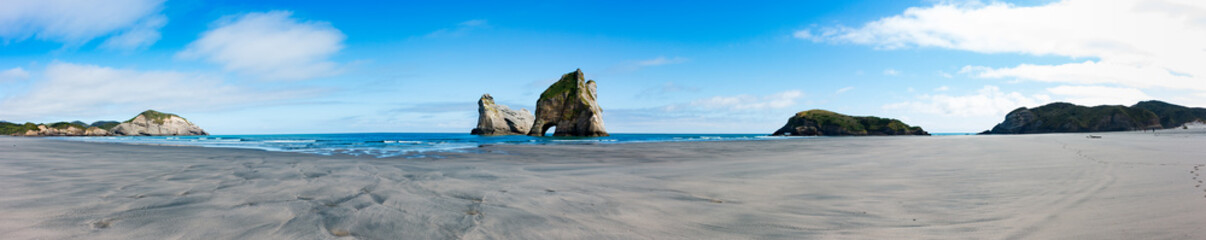 New Zealand wharariki beach and arch island rock formations