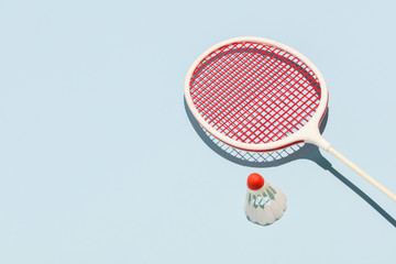 Oldschool racket and birdie on blue background