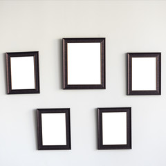 Blank wooden photo frames on the wall