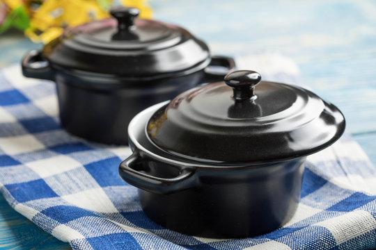 Mini black empty casserole.