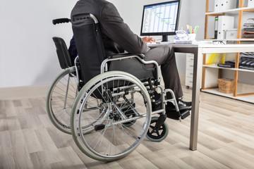 Businessman Sitting In Wheelchair
