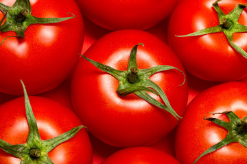 Healthy Eating. A Few Tomatoes Lie On A Red Background