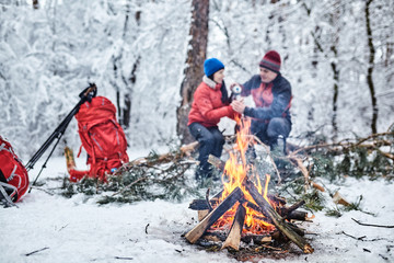 Tourists on a halt in the winter forest