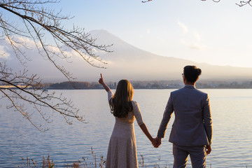 Tokyo, Japan - November 15, 2017 : Unidentified couple standing to relax and enjoying view of nature, Fuji from lake Kawaguchi-ko