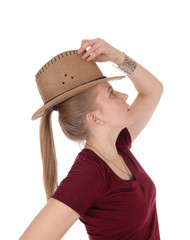 Woman posing with brown cowboy hat