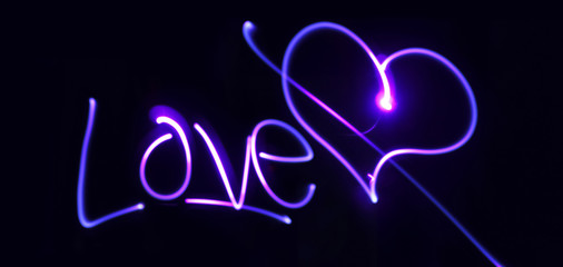 Neon heart and inscription Love on a dark background