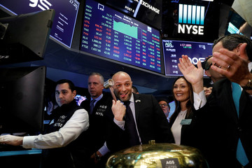 PlayAGS, Inc.'s President and CEO David Lopez celebrates his company's IPO on the floor of the New York Stock Exchange in New York