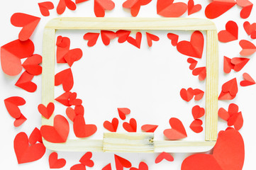 red paper shaped heart around whiteboard on white isolated background