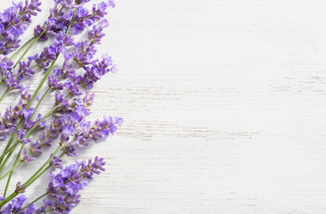 Sprigs of lavender on  wooden shabby background.