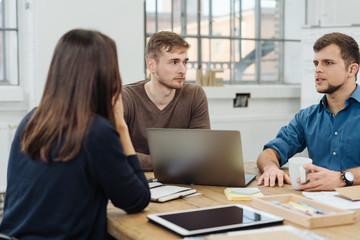 Three young businesspeople in a meeting