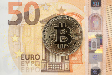 golden bitcoin and 50 Euro bill