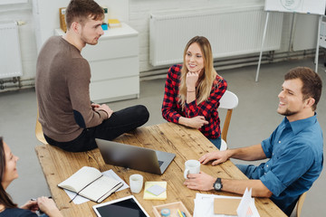 Four business partners having a relaxed meeting