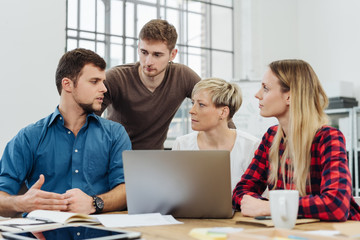 Group of people discussing project in office