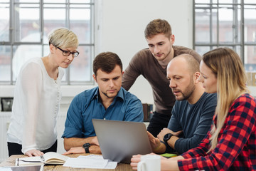 Young business team in a meeting with their leader