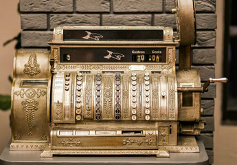 Antiques, an old cash register. Close - up