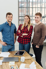 Three successful friendly young business people