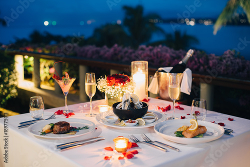 Romantic candlelight dinner table setup for Valentine\'s day with ...