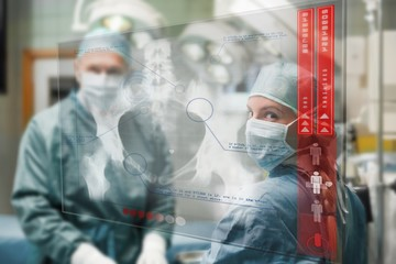 Surgeons checking holographic xray display