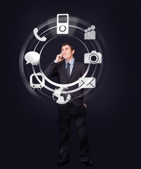 Businessman on the phone looking at wheel of applications light