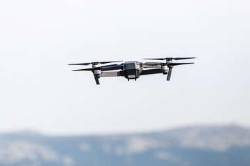 An aerial view of a flying multi-copter drone in the sky