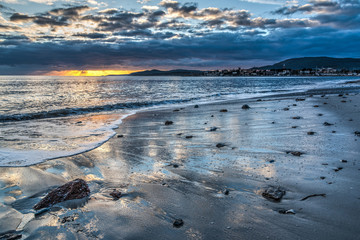 Reflections in Alghero shore at sunset