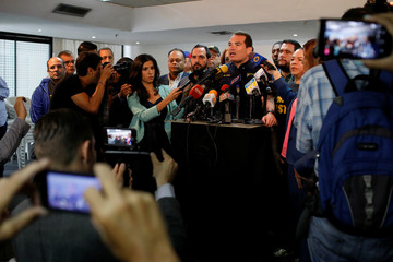 Tomas Guanipa, lawmaker of the opposition party Justice First (Primero Justicia), talks to the media during a news conference in Caracas