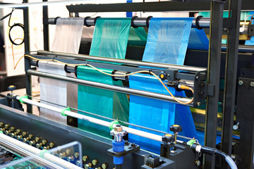 Machine for manufacturing plastic bags