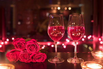 Wine and red roses.