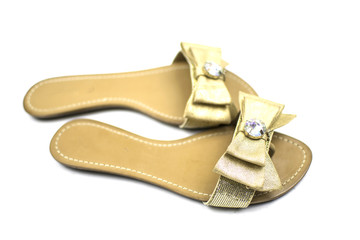 women's golden sandals, isolated