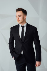 Portrait of handsome stylish man in elegant suit