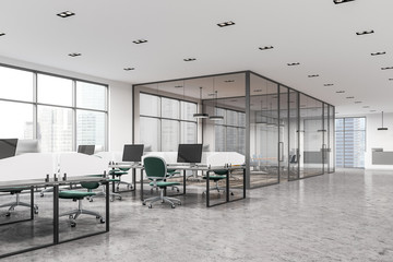 Open space office with green chairs, meeting room