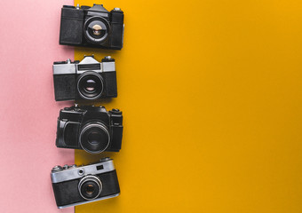 Vintage Film Cameras On Yellow And Pink Background. Creativity Retro Technology Concept