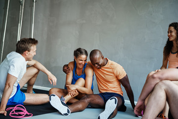 Friends laughing together after working out at the gym