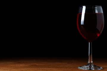 A glass of red wine on a black background, isolate
