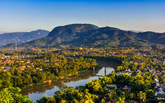 Luang Prabang, Laos, Southeast Asia: Landscape view over the city in the sunset lights from Mount Phousi, a sacred mountain located in the heart of the former capital of Laos