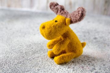 toy moose sits on gray stone floor