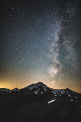 mountain and milky way in the night sky