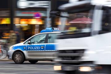 german police car speeding in city traffic