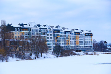 a multi-storey modern houses on the banks of the winter river