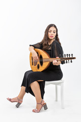 Oud playing women. Young woman playing lute string instrument