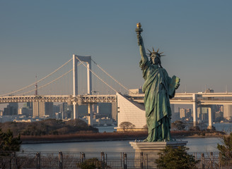 The replica Statue of Liberty with the Rainbow bridge in the background Odaiba Tokyo Japan