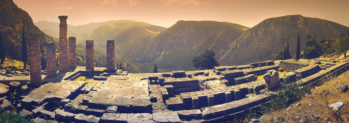 """Panoramic view of Apollo's temple in the famous archaeological site of Delphi in Greece which was believed during the antiquity to be """"the navel of the world"""""""