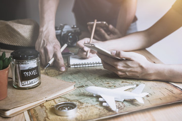 Young couple planning vacation trip and searching information