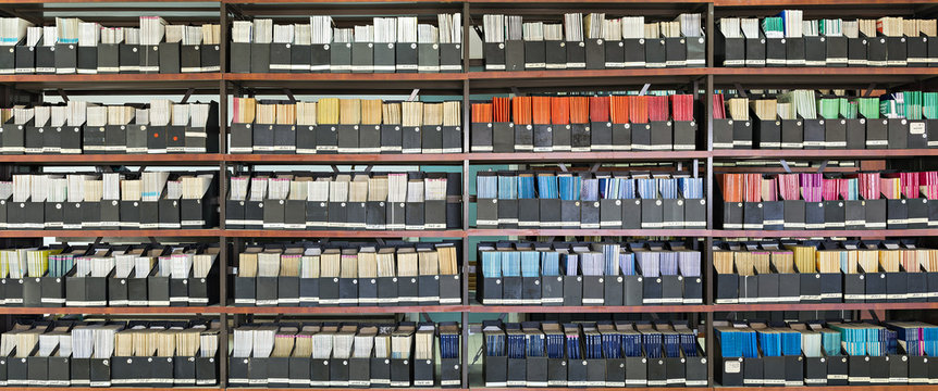 Shelves with old books in a library