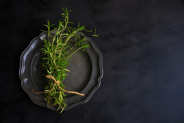Rosemary spice on dark wooden table