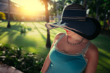 Beautiful young woman with sun hat enjoying her summer holiday in Punta Cana resort, Dominican Republic.