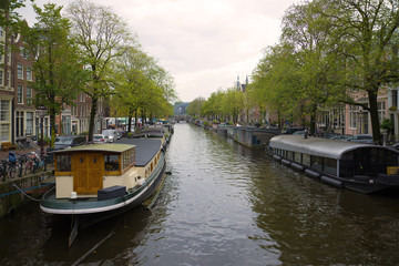 Residential house-boats on the Prince's canal on a cloudy September morning. Amsterdam