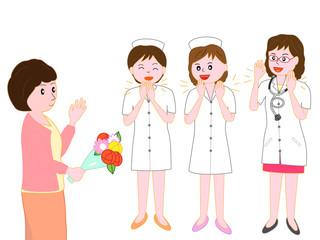 退院する患者を見送る医者と看護師